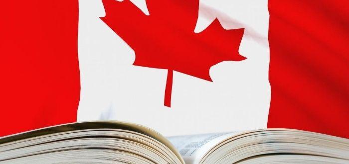 Libro abierto y bandera de Canadá